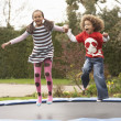 Stock Photo: Children Playing On Trampoline