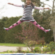 Girl Playing On Trampoline - Foto Stock