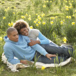 Couple Relaxing In Field Of Spring Daffodils — Stock Photo #4842180