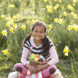Girl On Easter Egg Hunt In Daffodil Field — Stock Photo