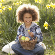 Boy On Easter Egg Hunt In Daffodil Field — Stock Photo