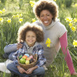 Mother And Son On Easter Egg Hunt In Daffodil Field — Stock Photo #4842210