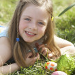 Mother And Daughter On Easter Egg Hunt In Daffodil Field — Stockfoto #4842244