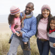 Family Walking Along Dunes On Winter Beach — Foto Stock