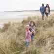 Family Walking Along Dunes On Winter Beach — 图库照片