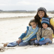 Mother And Children On Winter Beach — Stock Photo
