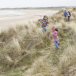 Family Walking Along Dunes On Winter Beach — Stock Photo