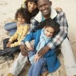 Family Sitting On Winter Beach — Stock Photo