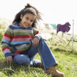 Stockfoto: Young Girl Sitting Outside In CaravPark