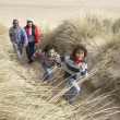 Family Walking Along Dunes On Winter Beach — Photo