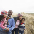 Black Family on a beach — Stock Photo