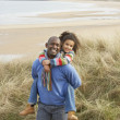 Black Family on beach — Stockfoto #4842475