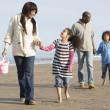 Black Family on a beach - Stockfoto