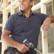Construction Worker Building Timber Frame In New Home — Stock Photo