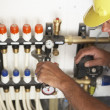 Plumber Working On Pipework In New Home — Stock Photo #4842505