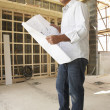 Architect With Plans In New Home — ストック写真 #4842527