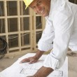 Architect Studying Plans In New Home — Stockfoto