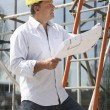 Architect Studying Plans Outside New Home — Foto de Stock