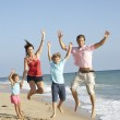 Portrait Of Family On Beach Holiday Jumping In Air — Stock Photo