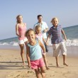 Portrait Of Running Family On Beach Holiday — Stock Photo