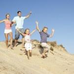 Family Enjoying Beach Holiday Running Down Dune — Stock Photo
