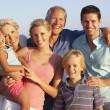 Portrait Of Three Generation Family On Beach Holiday — Stock Photo