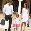 Stock Photo: Young Family Enjoying Shopping Trip Together