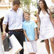 Young Family Enjoying Shopping Trip Together - Photo