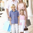 Young Family Enjoying Shopping Trip Together — Stock Photo #4842780