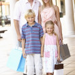 Young Family Enjoying Shopping Trip Together — Stock Photo