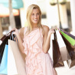 Stock Photo: Young WomEnjoying Shopping Trip