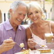 Senior Couple Enjoying Coffee And Cake In Caf — Stock Photo
