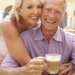 Senior Couple Enjoying Coffee And Cake In Caf — Stock Photo #4842814