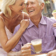 Senior Couple Enjoying Coffee And Cake In Caf — Stock Photo #4842815