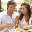 Young Couple Enjoying Coffee And Cake In Caf — Stock Photo #4842818