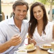 Young Couple Enjoying Coffee And Cake In Caf — Foto de Stock