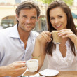 Young Couple Enjoying Coffee And Cake In Caf — Stock Photo #4842825