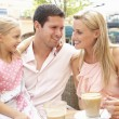 Young Family Enjoying Cup Of Coffee In Caf — Stock Photo #4842855