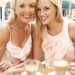 Two Women Enjoying Cup Of Coffee In Caf — Stock Photo
