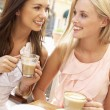 Two Young Women Enjoying Cup Of Coffee In Caf — Stock Photo #4842884