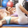 Women Doing Stretching Exercises In Gym — Stock Photo #4842904