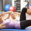 Women Doing Stretching Exercises In Gym — Stock Photo #4842905