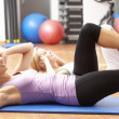 Women Doing Stretching Exercises In Gym — Stock Photo #4842906