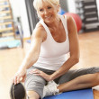 Senior Woman Doing Stretching Exercises In Gym — Foto Stock