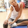 Senior Woman Doing Stretching Exercises In Gym — Stock Photo