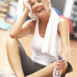 Stock Photo: Senior Woman Resting After Exercises In Gym