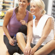 Woman Doing Stretching Exercises In Gym With Trainer — Stock Photo