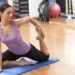Woman Doing Stretching Exercises In Gym — Stock Photo