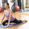 Woman Doing Stretching Exercises In Gym — Stock Photo #4842937