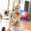 Young Woman Doing Stretching Exercises In Gym — Stock Photo #4842947